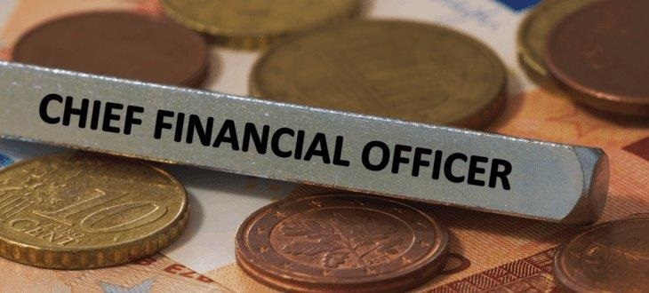 Chief financial officer label placed amongst coins